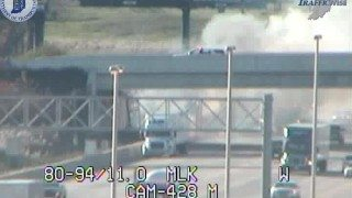 (Fire crews on Georgia St. overpass dumping water on semi fire.  Image courtesy of INDOT)